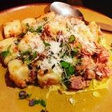 Homemade potato gnocchi with white wild boar ragu